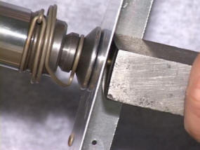 Demonstration of bucking bar use when riveting